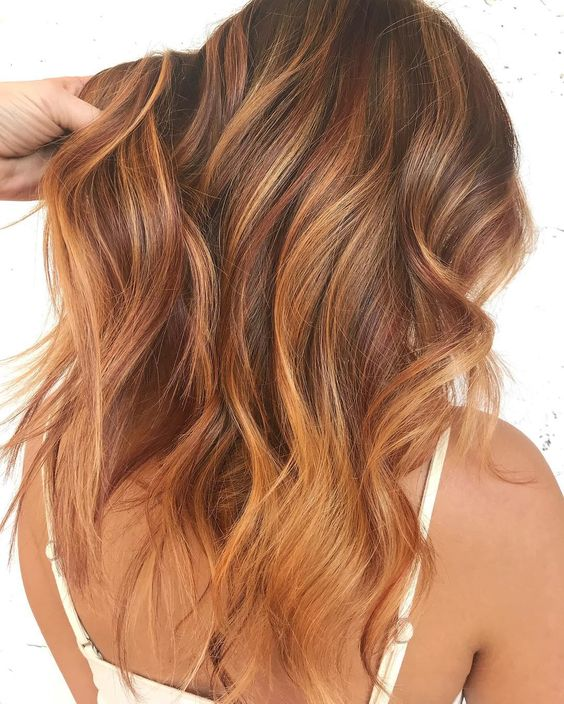 We love this strawberry blonde and copper look; this fun color can be tried out with a semi-permanent color on pre-lightened hair for a noncommittal change!