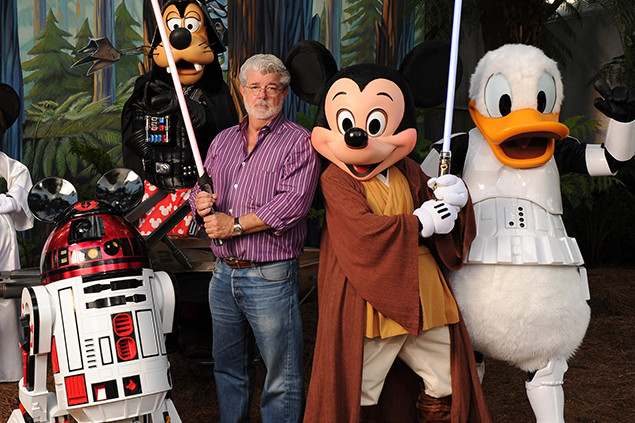 "(Aug. 14, 2010):  ""Star Wars"" creator and filmmaker George Lucas poses with a group of ""Star Wars""-inspired Disney characters Aug. 14, 2010 at Disney's Hollywood Studios theme park in Lake Buena Vista, Fla.  Lucas is in central Florida for ""Star Wars Celebration V,"" the official Lucasfilm fan event that is taking place this week at the Orange County Convention Center in Orlando, Fla. He visited Walt Disney World Resort tonight to attend Disney's ""Last Tour to Endor"" special event.  (Todd Anderson, photographer)"