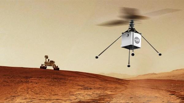 Animação com Mars Helicopter da NASA, um pequeno helicóptero autônomo, que viajará com o rover Mars 2020 (visto ao fundo) da NASA. Ambos estão programados para ser lançados em julho de 2020. A finalidade é demonstrar a viabilidade e o potencial de veículos mais pesados que o ar no Planeta Vermelho. (Crédito: NASA / JPL-Caltech)