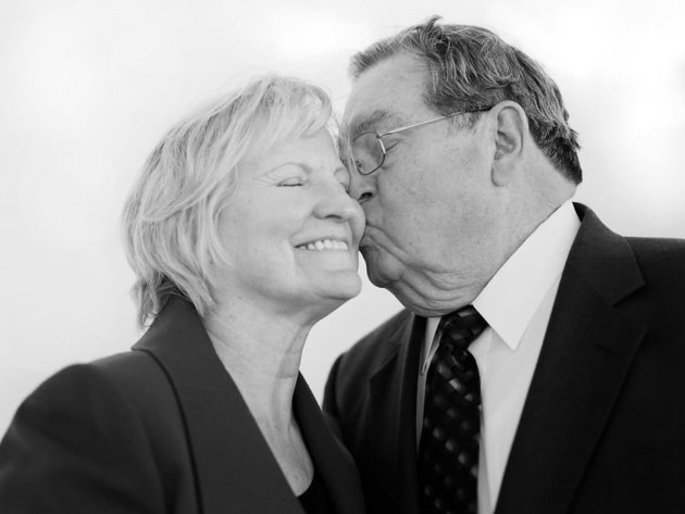 """""""We met when I was working at a women's dress shop in California, and he was working next door at a men's clothing store. Every morning we'd both go out to sweep the sidewalk. One day our brooms met, and we fell in love on that sidewalk in front of those stores. We talked everyday and he swept me off my feet!"""" - Andrew & Norma, married 57 years at the time of the interview"""