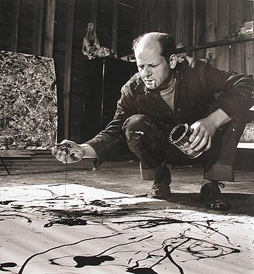 Jackson Pollock painting in his studio, Springs, New York, 1949 © Time Inc