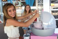 Mandy Kokalas' daughters stirred up some serious cotton candy in front of Mandy's Candies store.