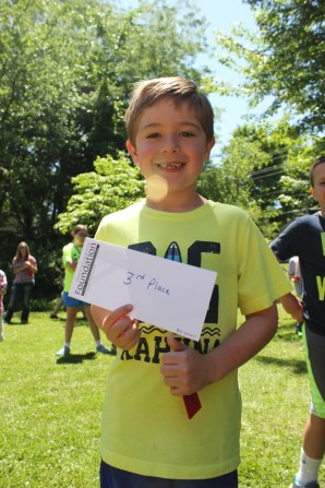 Duck Derby winner Hunter Noel of Marci Bailey's first grade class at Sunset School, displays his 3rd place prize.