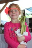 """There should be plenty of rhubarb available during opening day of the market as this """"awesome sister"""" holds on tight to her package last year."""