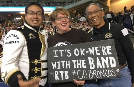 Raegan Soekarmoen, a member of the WMU marching band with his parents Kelly and Didik Soekarmoen of Vicksburg at the Cotton Bowl game in Arlington, TX.