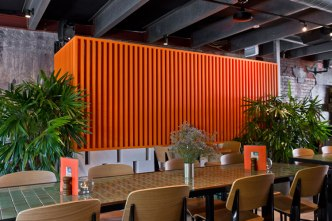 So_Cal-dining-and-orange-wall