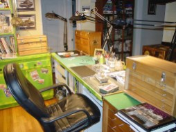 Note the Tiger I on the workbench and the Tiger bible at right.