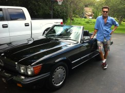 Happy 560sl owner in his madras shorts and Wayfarers.