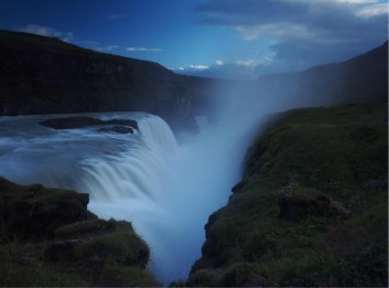 The lower tier of Gullfoss drops into a deep canyon that is almost completely hidden by the wild spray, which can be seen several kilometres away