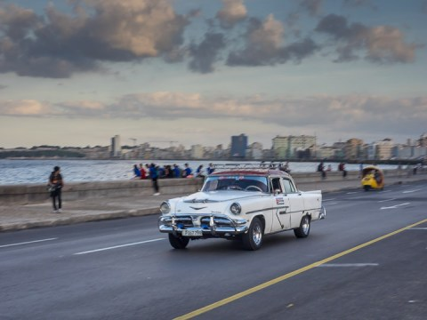 In Cuba the road running next to the sea in a city is called a malecón. Havana's famous malecón is a fun place to snap photos of vintage cars.