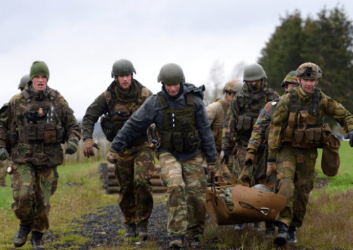 Medics carry simulated wounded during combat lifesaver training at NATO ISTC NSOCM Course (Photo Credit: Jason Johnston).