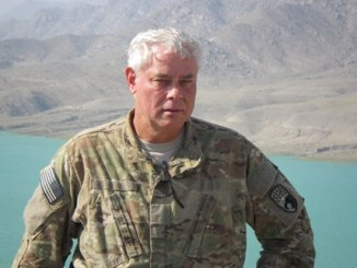 John Friberg at Sarobi Lake, Afghanistan while visiting a French brigade in July 2012 while serving as a Counterinsurgency Advisor assigned to the COMISAF Advisory and Assistance Team (CAAT).