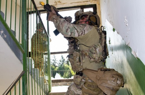 A member of 20th Special Forces Group clears a stairwell during Exercise Black Swan 2017 (Photo SSG Aaron Duncan, SOCEUR, July 19, 2017.
