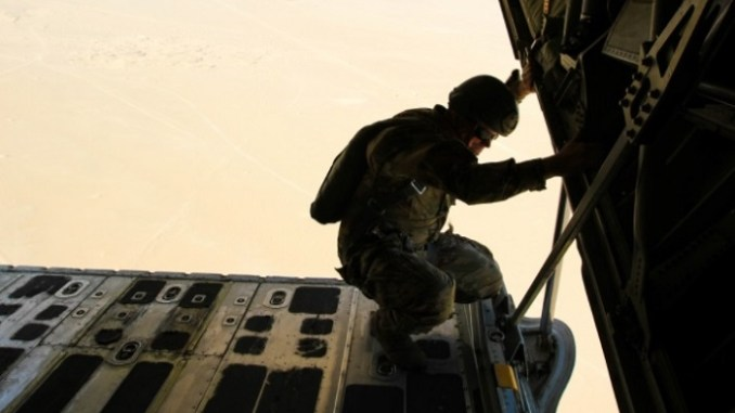 AMP BUEHRING, Kuwait (Oct. 17, 2017) – SFC Jonathan Newell, headquarters NCOIC for the 7th SFG, monitors jumpers during their descent. The air mission was a recertification jump monitored by members of the SOJTF and 1st TSC. (U.S. Army photo by Capt. Jacqueline Whitt)