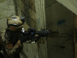 Student in the Advance Operators Training Course (AOTC) clears a room in live fire shoot house in Baghdad, Iraq on December 19, 2019. Photo by SGT Brandon Franklin, 10th SFGA.