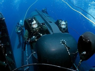 SEALs prepare to launch Swimmer Delivery Vehicle (SDV) from the back of the USS Philadelphia. The SDVs are used to carry Navy SEALs from a submerged submarine to enemy targets while staying underwater and undetected. U.S. Navy photo by Chief Photographer's Mate Andrew McKaskle, May 5, 2005.