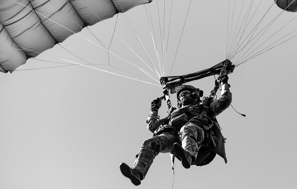 A U.S. Army Green Beret assigned to 19th Special Forces Group lands during a military freefall operation near Cincu, Romania while participating in Trojan Footprint 19. (SOCEUR, June 2019).