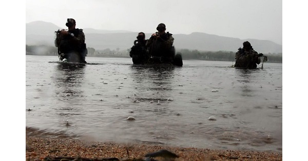 Combat Divers emerge from water