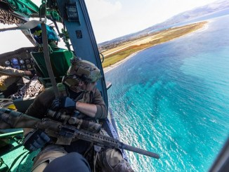 Special Forces Sniper on Helicopter