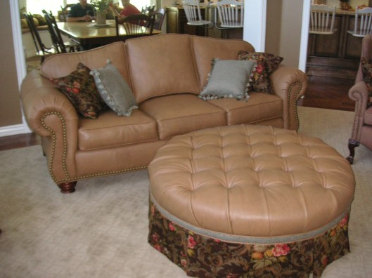 Rolled arm Camel Back Sofa and Tufted Round Ottoman