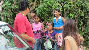 Kids from Roberto Barrio trying to sell things their mothers have done.