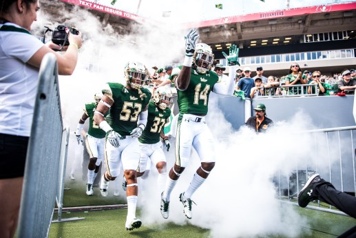 24 USF vs ECU 2016 - USF WR Deangelo Antoine LB Danny Thomas and DB Nate Ferguson exiting the tunnel (6016x4016)