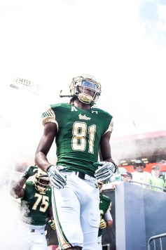 29 USF vs ECU 2016 - USF WR Ryeshene Bronson and OL Kofi Amichia exiting the tunnel (2681x4016)