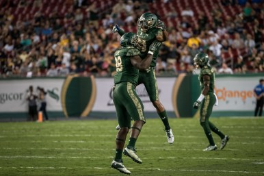 50 - Navy vs. USF 2016 - USF DB Ronnie Hoggins DE Mike Love by Dennis Akers | SoFloBulls.com (3490x2327)