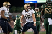 78 - Navy vs. USF 2016 - Navy QB Will Worth USF LB Danny Thomas by Dennis Akers | SoFloBulls.com (6016x4016)