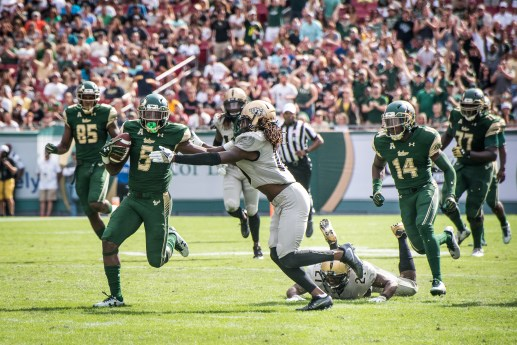 35 - USF vs. UCF 2016 - USF RB Marlon Mack stiff arms UCF DB Shaquill Griffin for TD by Dennis Akers | SoFloBulls.com (4049x2703)