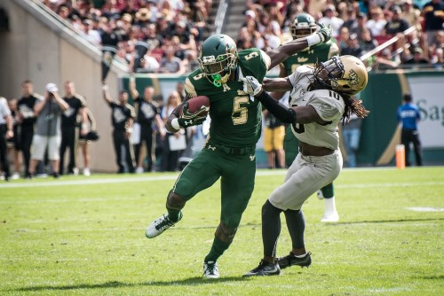 36 - USF vs. UCF 2016 - USF RB Marlon Mack stiff arms UCF DB Shaquill Griffin for TD by Dennis Akers | SoFloBulls.com (3059x2042)