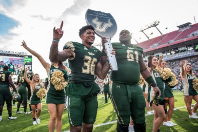 97 - USF vs. UCF 2016 - USF S Nate Godwin and OL Dominique Threatt holding #WarOnI4 Trophy by Dennis Akers | SoFloBulls.com (5259x3511)
