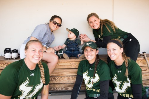 2017 USF Bulls Softball Players Greeting Sonny Akers in dugout by Dennis Akers | SoFloBulls.com