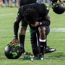 58 - USF vs. UConn 2018 - USF Kneels in Prayer Pre-Game in Adidas So Flo Uniform by Will Turner | SoFloBulls.com (2614x2613) - 0H8A8422