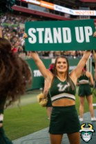 117 - BYU vs USF 2019 - Cheerleader holding Stand Up sign by David Gold - DRG01421