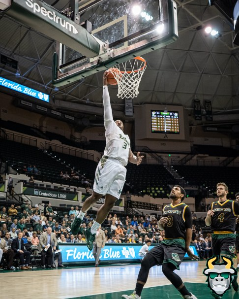 26 - St. Leo vs South Florida Men's Basketball 2019 - Laquincy Rideau at the rim by David Gold - DRG03060