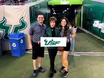 SoFloBulls Owners Matthew and Stephanie Manuri with USF President Judy Genshaft vs. Cincinnati 2017