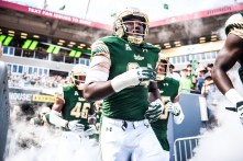 28 USF vs ECU 2016 - USF DE Kirk Livingstone and DB Shannon Smith exiting the tunnel (6016x4016)