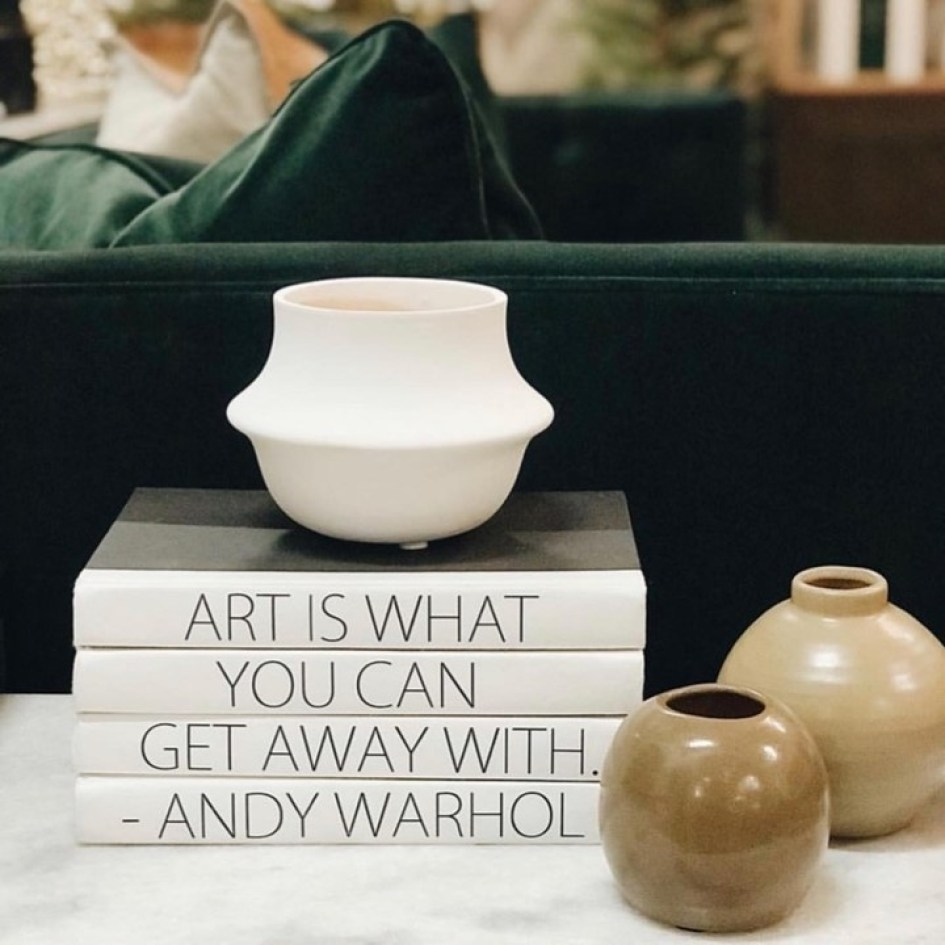 Art quote made up of decorative bound books.