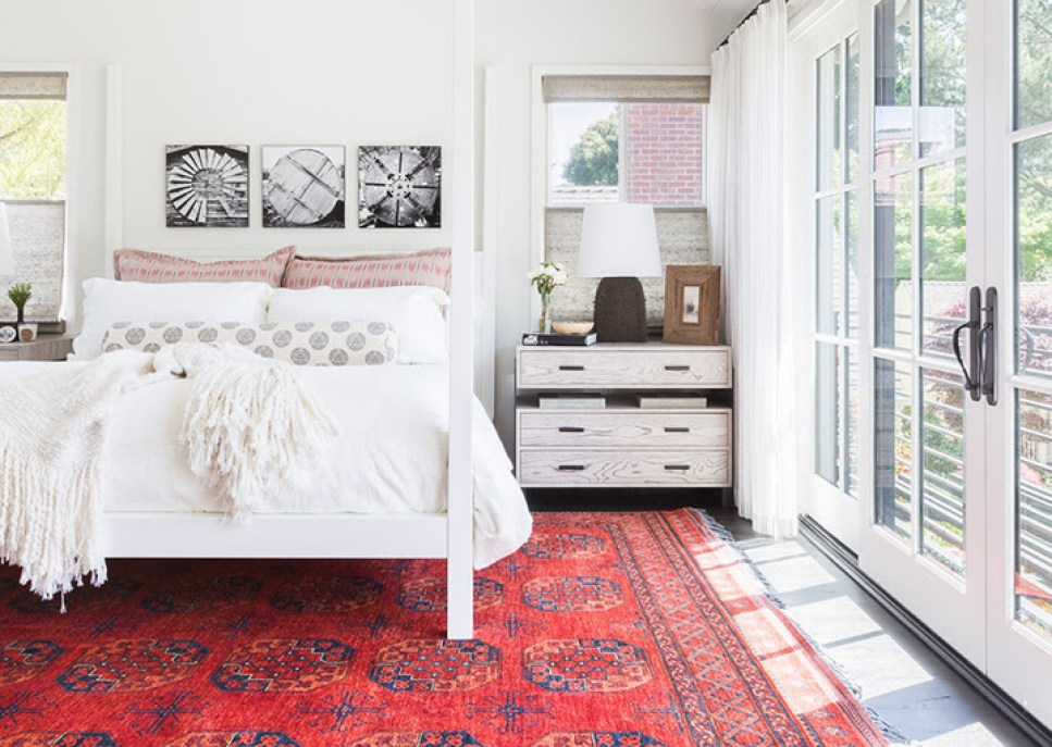 """A red Oriental rug with other touches of red in accents can nicely """"set"""" a room."""