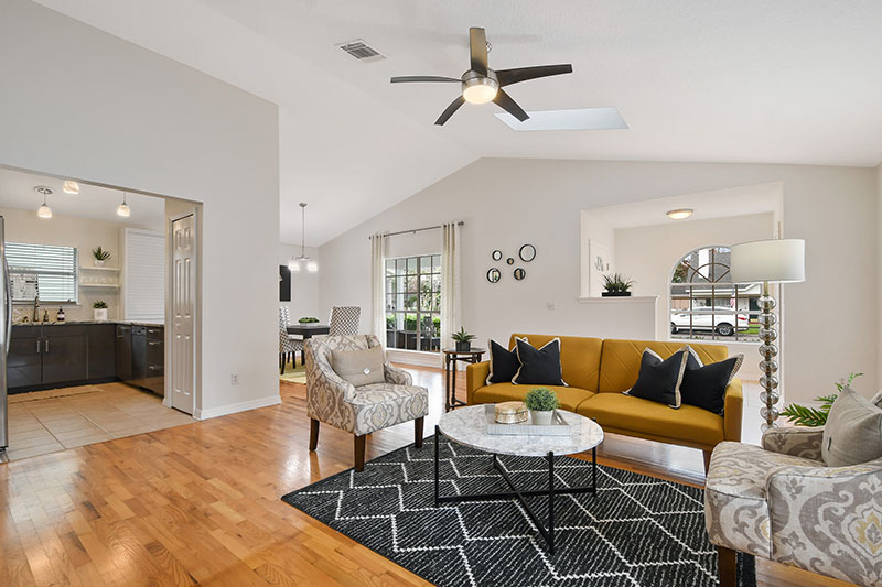 Bright, cheery living room area, inviting home!