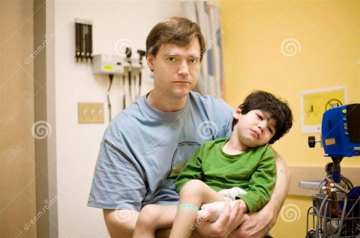 worried-father-holding-his-sick-son-hospital