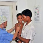 child being examined at CSC in cambodia