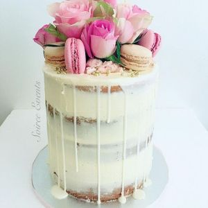 Fresh rose and macaron semi naked drip cake