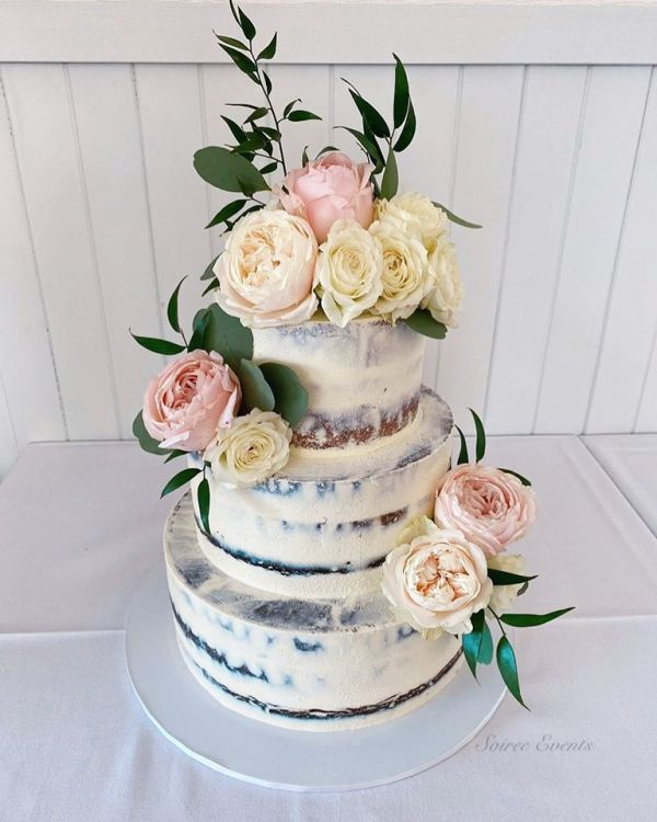 three tier semi naked cake with fresh roses
