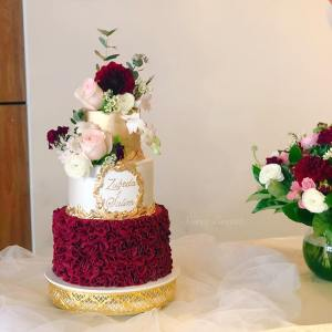 gold and burgundy ruffle cake