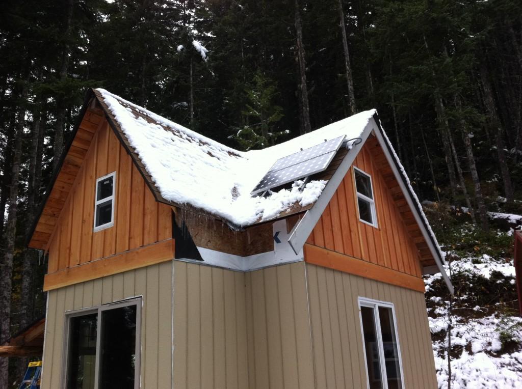 off grid cabin solar panels in snow