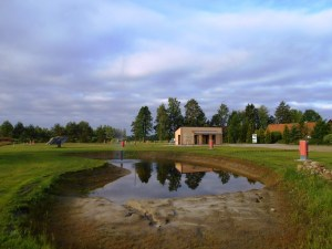 The pond and WC/shower facilities in the background