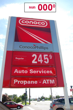gas station sign with price of sun -- 000 -- superimposed on it