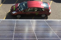 Prius under a solar array.
